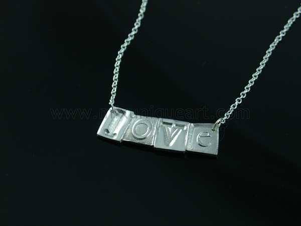 Art Clay Silver pendent with word: LOVE